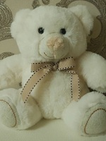 Soft toy teddy bear with bow, white