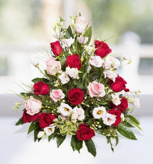 Flower arrangement of red and pink roses